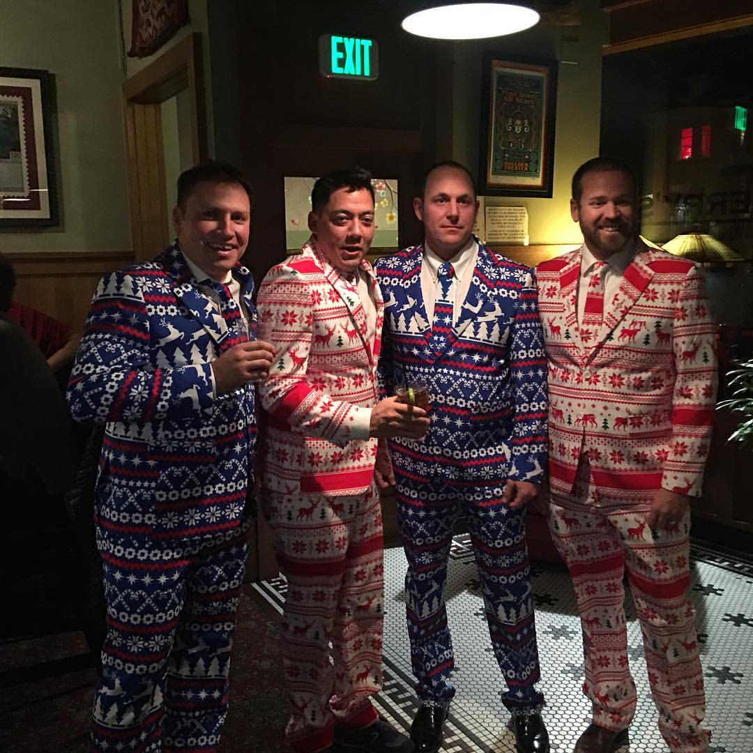 matching suits at the holiday party